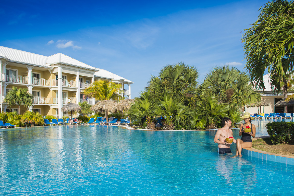 Sipping a drink around the pool is the perfect way to start your vacation